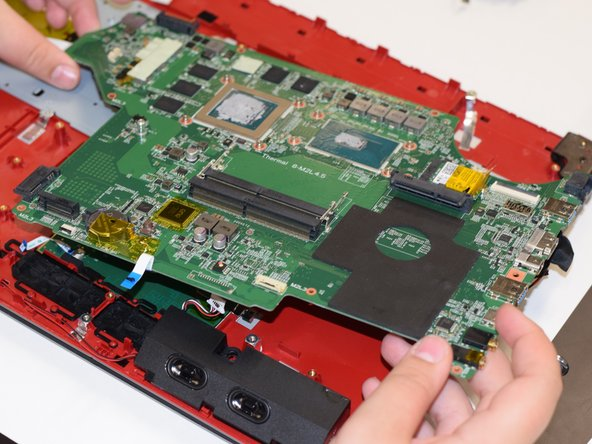 Here, highlighted in red are a series of plugs you will have to remove.  Once you have completely detached the motherboard from any remaining items, carefully pull it out.