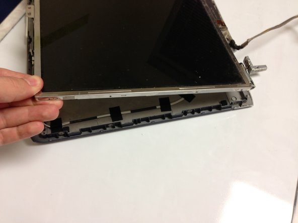 Carefully lift and remove the LCD display with both hands.