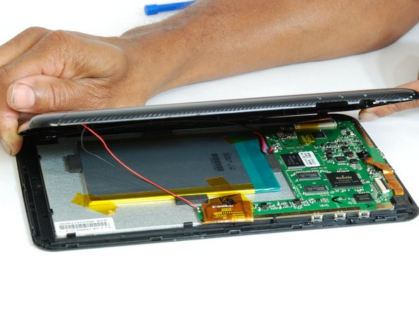 Once all connections have been loosened and using a soft surface, place the device onto its screen.