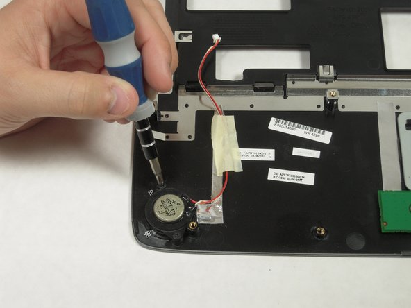 Remove two screws from each speaker with the Phillips Screwdriver.