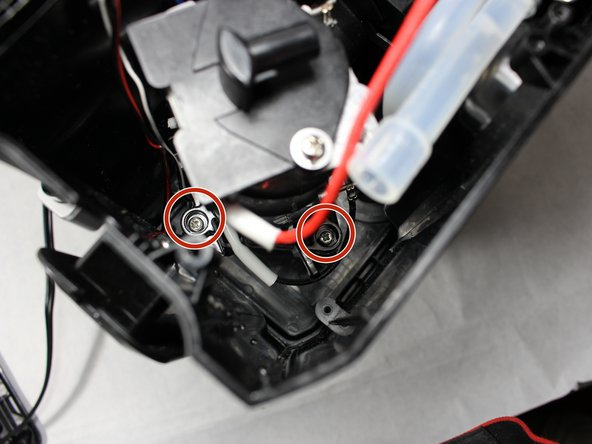 Using a #1 Phillips head screwdriver with an extension, remove three 6mm screws  holding the heater to the unit.