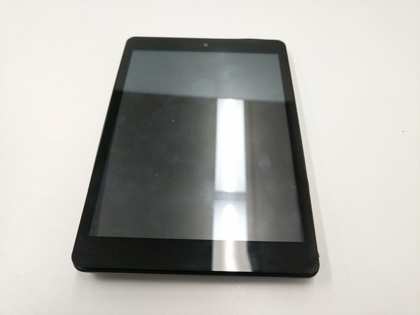 Place the tablet on a flat surface, facing upwards.