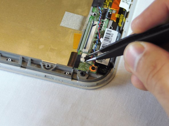 Use the fine pointed tweezers to carefully remove the 2 no-fuss speaker connections.