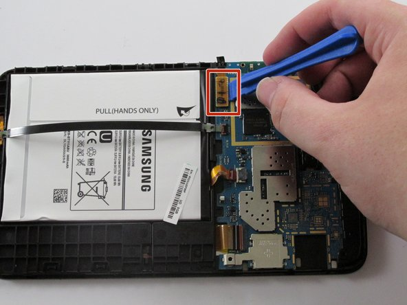 Use the plastic opening tool and gently pry up the tab holding the motherboard in place.