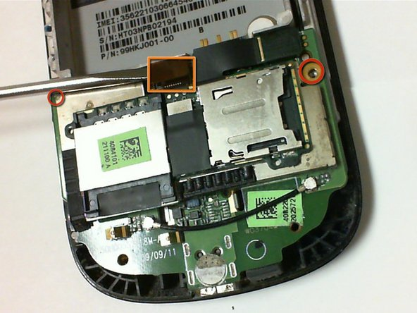 Remove the two Phillips head 3 mm screws located on the bottom circuit board.