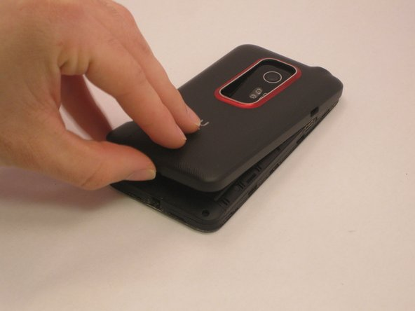 Remove the outer casing of the phone with your hands by prying and lifting at the latch.