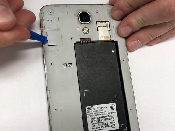 Using the pry tool, carefully pop the  Digitizer cover off the device.