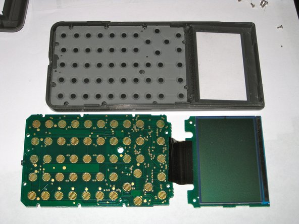 The screen and main board will lift out, leaving the membrane keypad in the front case.