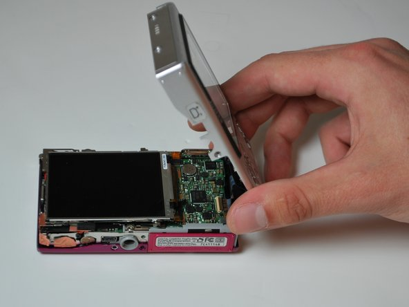 Image 3/3: There will be a ribbon cable attaching the front panel to the motherboard, be sure not to tear this.