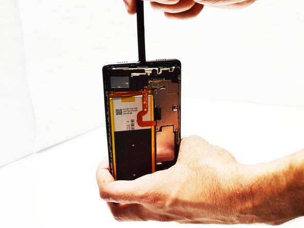 Use Spudger tool  to gently lift loudspeaker from phone. The loudspeaker is the entire portion of the phone where the screws were extracted. Replace the loudspeaker with the new one,  and reassemble the phone in reverse order.