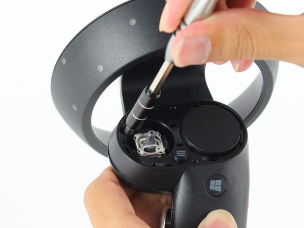 Remove one 6mm Phillips #0 screw.