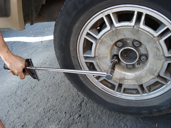Loosen each of the five lug nuts on all tires by turning them counter-clockwise with a 19mm wrench.