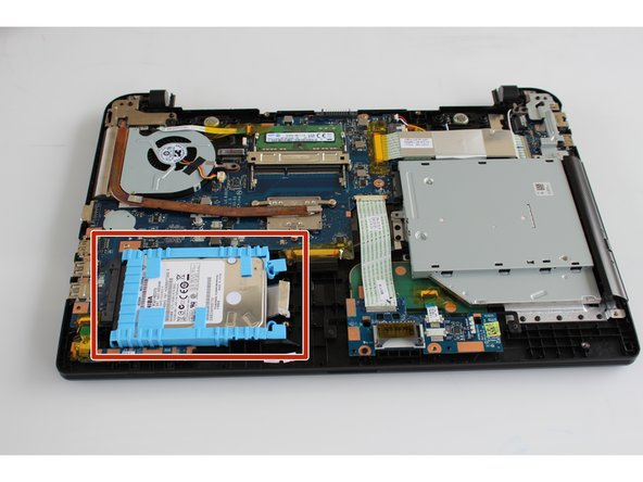 Once the device is open from the bottom, look for the bright blue plastic frame which encases the hard drive