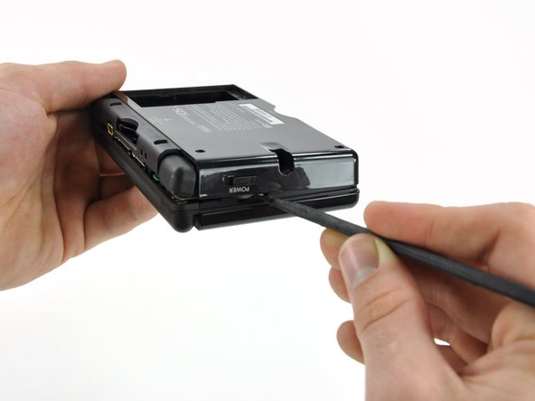 Carefully run the spudger along the right edge of the DS Lite, creating an opening in the process.