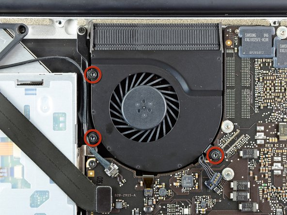 Image 1/2: Remove the three 3.4 mm (3.1 mm) T6 Torx screws securing the right fan to the logic board.