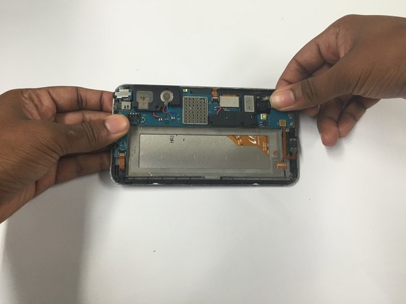 Gently put in the new rear facing and front facing camera and snap the tab back onto the motherboard.