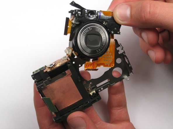 On most cameras, the lens assembly is one of the last components that can be removed. Be patient when removing it, because it is fragile.