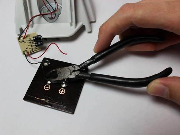 Clip the second wire the same way.