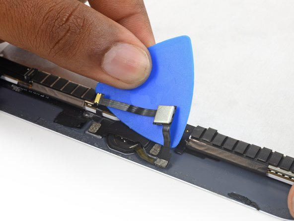 Use an opening pick to continue separating the home button ribbon cable from the display assembly.