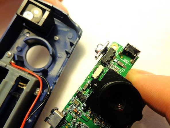 Carefully lift the circuit board from the casing.  Be sure to not detach the wires from the circuit board or the case.