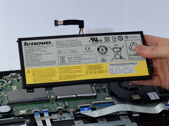 Set the battery aside. This will allow easier access to the connector for the HDD.