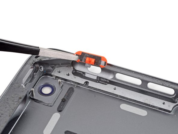 Note the orientation for reassembly: the small gray tab should line up with the groove in the rear case.