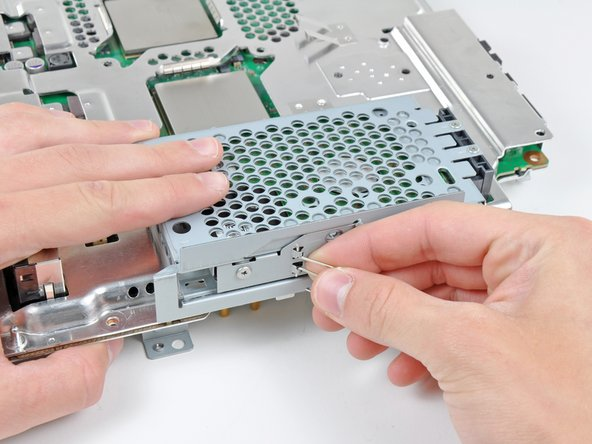 Push the hard drive cage toward the front of the motherboard assembly.