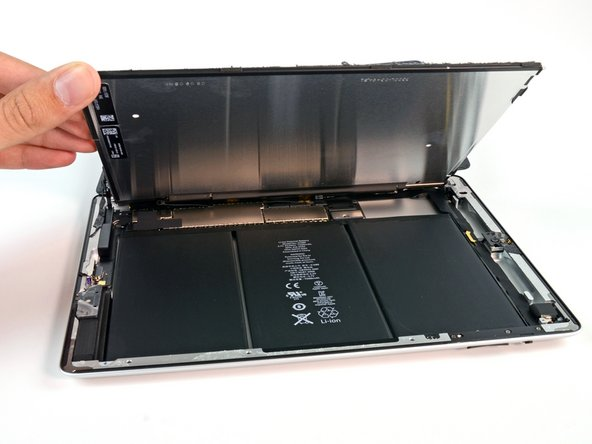 We lift up the LCD to reveal the battery.