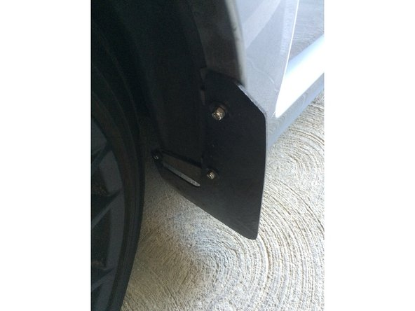 Make sure the mud flaps are all properly tightened and positioned before driving your car again.