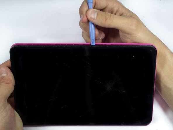Use the plastic opening tools to loosen and then pry the back if the tablet off.