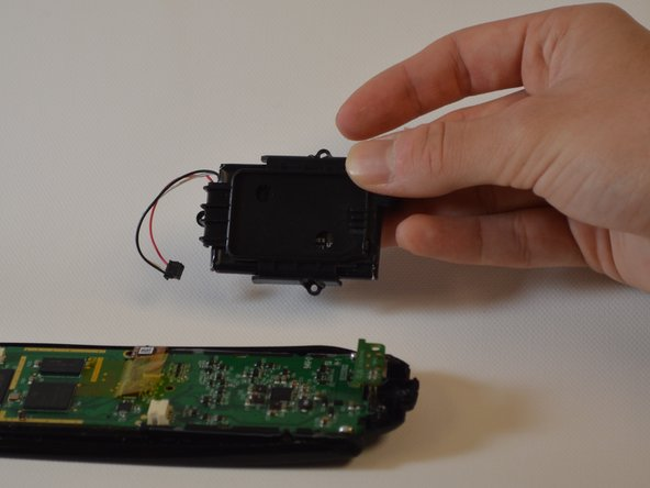 Lift the battery and its case out of the remote.