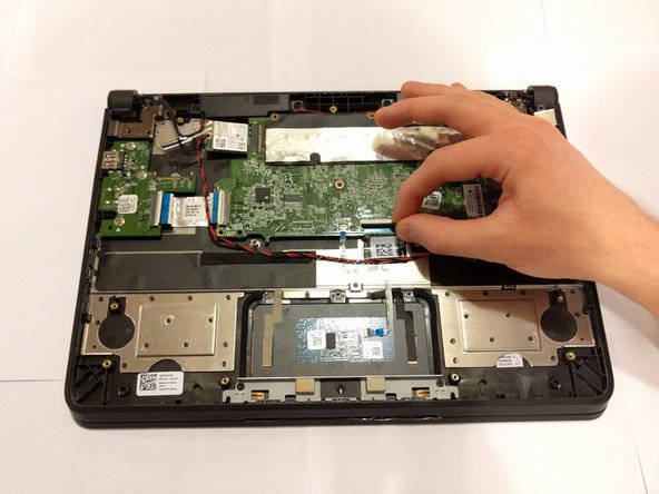 """Gently remove the display ribbon cable that says """"NON-TOUCH"""" on its tag. This ribbon cable does not have a locking switch, but there is a wire metal latch that should be lifted up before pulling the ribbon."""