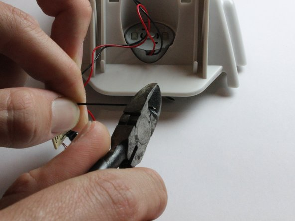 Strip the insulation off the wires to reveal the copper beneath.