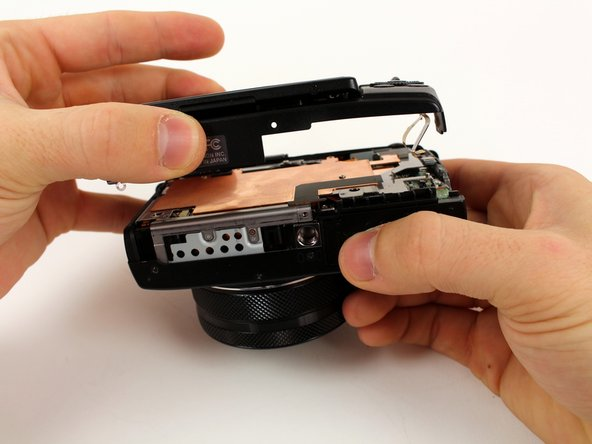 Carefully lift the back casing away from the camera.