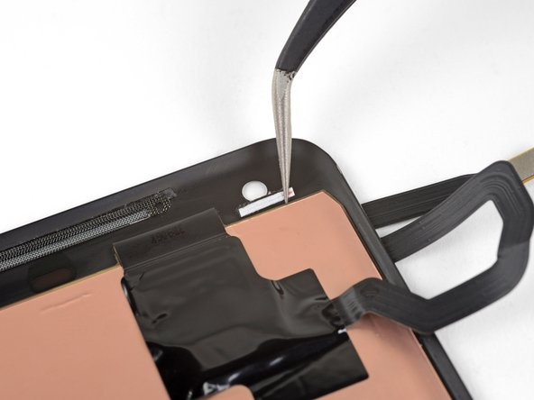 If you're reusing the camera gasket from your old screen, the old adhesive may have stuck to the gasket when you removed it. If this is the case, and the adhesive is still sticky, skip to the last step.