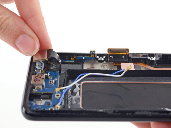 Gently fold the motherboard connector toward the bottom of the phone and out of the way of the antenna ribbon cable.
