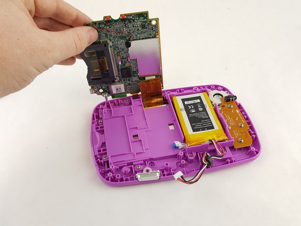Image 1/3: Disconnect the gold display assembly cord with an opening tool to fully disconnect the motherboard.