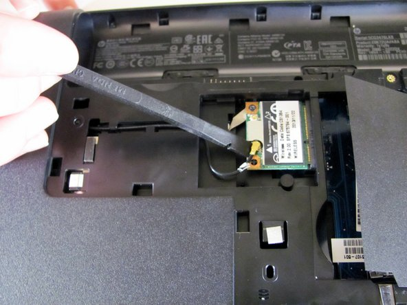 Using a plastic spudger, disconnect the gold-end of the connecting wire from the wireless module.