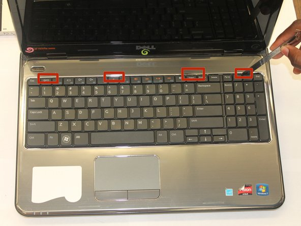 There are a number of screws on the bottom that required to be removed prior to the keyboard being able to be lifted up.