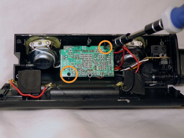 Image 1/1: Remove the damaged circuit board from the device.