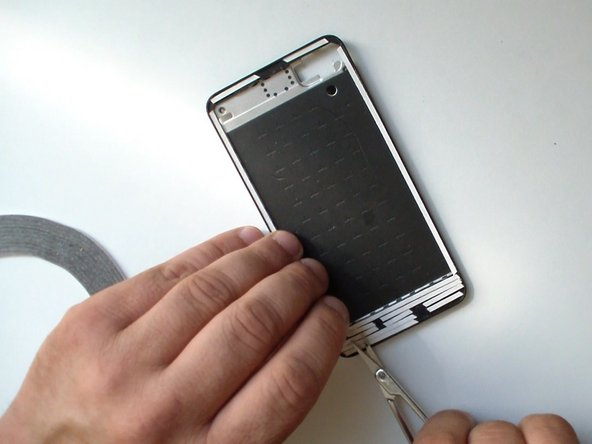 Image 2/3: Be careful, don't cover the technological openings on the middle frame (for the light sensor, earpiece, etc.).