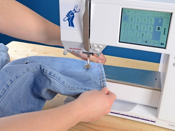 Slide the pant leg onto the arm of the sewing machine.