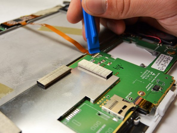 Disconnect the flat ribbon cable by disconnecting the zero insertion force (ZIF) connector.