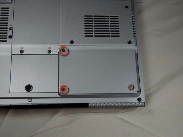 Identify the two screws that attach the hard drive access panel.