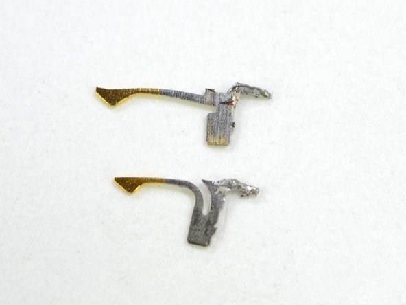 Image 3/3: Each pin (shown in the third picture) is springy and gold plated on the end to ensure good conductivity between the Lightning cable and the socket.