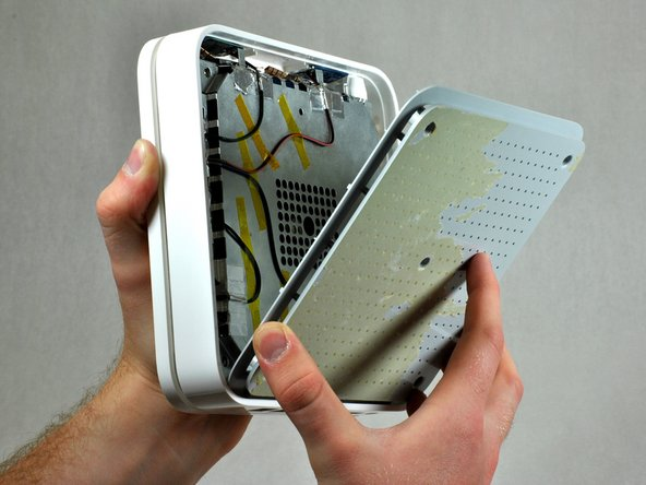 When installing the plastic back cover, ensure the lip is aligned with the ports on the back of the device.