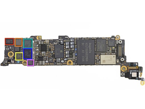 Image 1/1: The underside of the logic board is teeming with components.