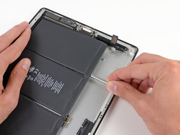 As you push the spudger further underneath the battery, keep it as flat against the rear case as possible to avoid bending the battery.