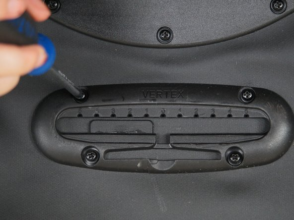 To remove bottom stay bracket, first unscrew all 4 screws. To do so, undo velcro flap located at the top of the laptop sleeve. With the wrench, hold nut in place in the back of the pannier, while using the screwdriver to unscrew the screw in the front bracket.