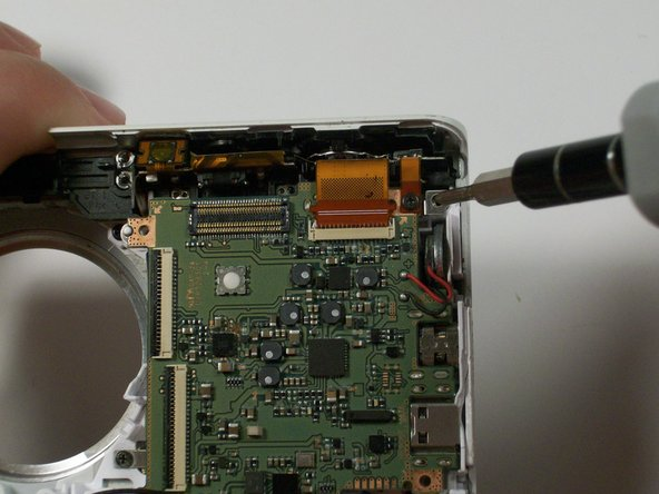 Remove the 2.381 mm screw that is holding the copper to the control board with a Phillips #00 screw driver.